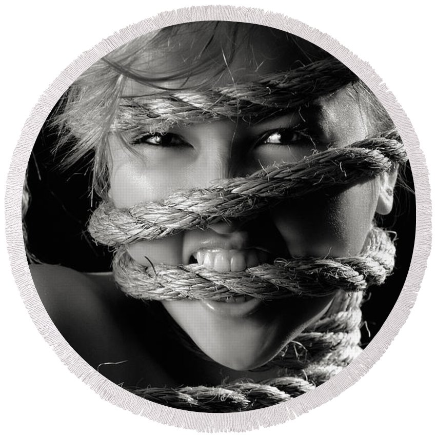 Angry Round Beach Towel featuring the photograph Young Expressive Woman Tied In Ropes by Maxim Images Prints