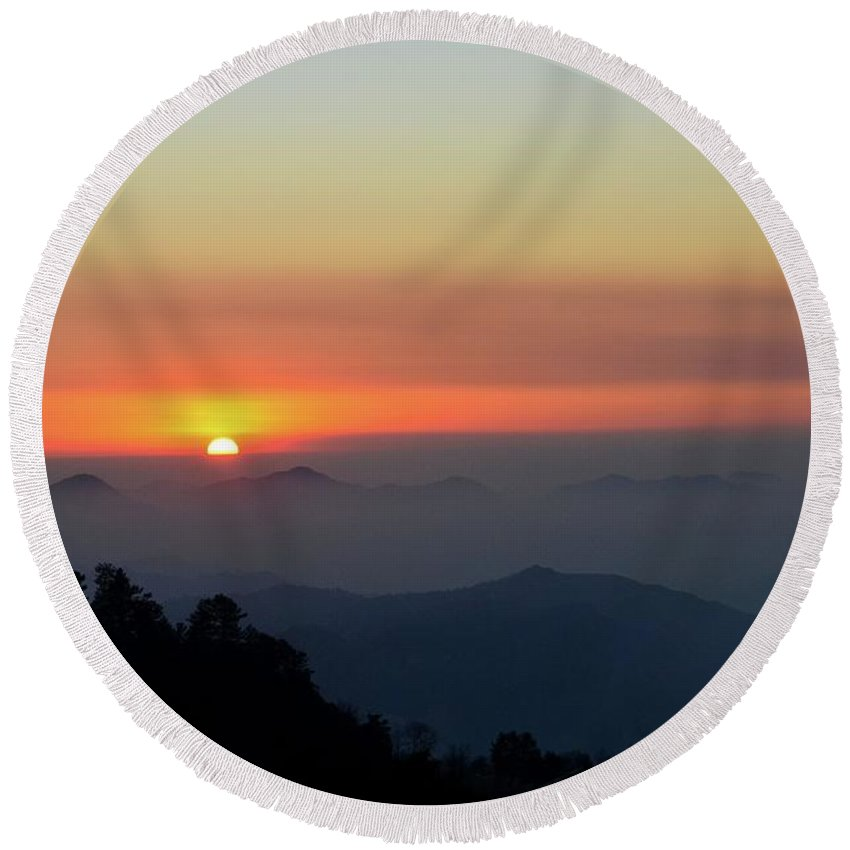 Sunset Over Mountains And Trees Of Murree Punjab Pakistan Round Beach Towel