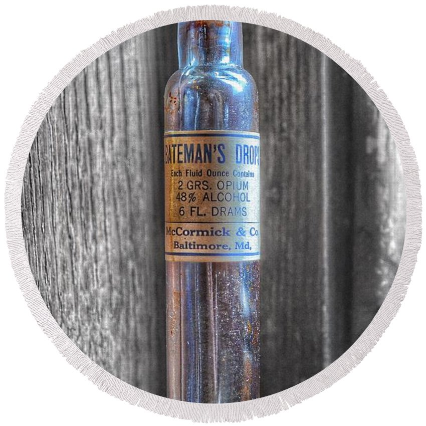 Bateman's Drops Round Beach Towel featuring the photograph Antique Mccormick And Co Baltimore Md Bateman's Drops Opium Bottle by Marianna Mills