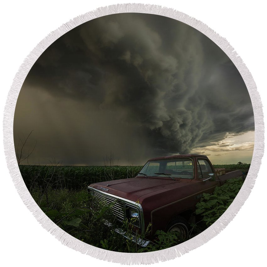 Severe Round Beach Towel featuring the photograph Get Outta Dodge by Aaron J Groen