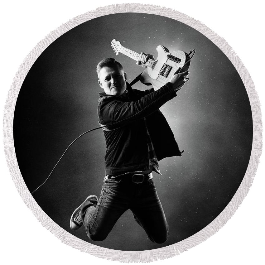 Guitarist Round Beach Towel featuring the photograph Guitarist Jumping High by Johan Swanepoel