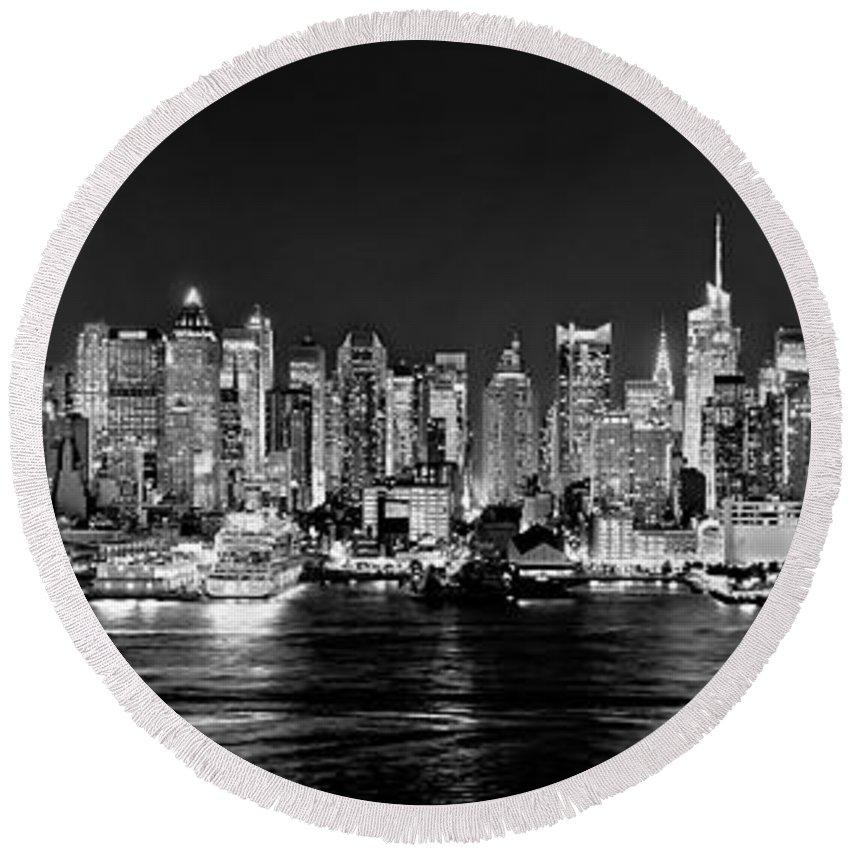 New York City Skyline At Night Round Beach Towel featuring the photograph New York City Nyc Skyline Midtown Manhattan At Night Black And White by Jon Holiday