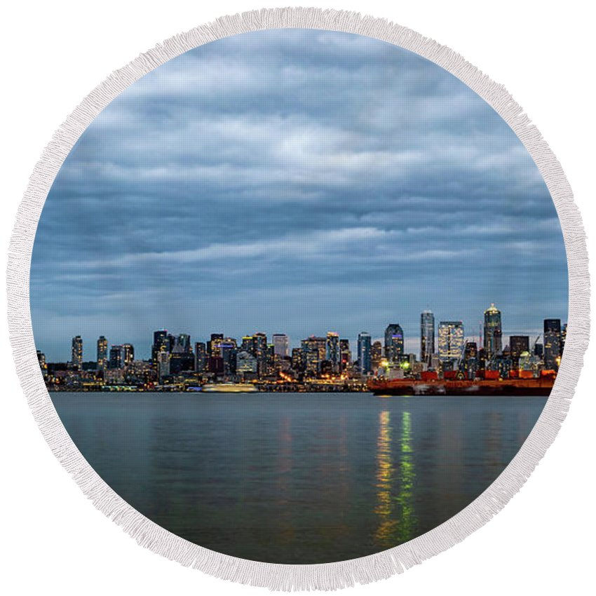 Clouds Round Beach Towel featuring the photograph Panorama Of Seattle Skyline At Night With Storm Clouds by PorqueNo Studios