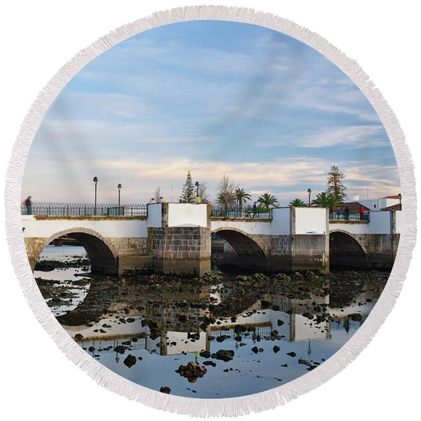 Portugal Round Beach Towel featuring the photograph The Antique Bridge Of Tavira. Portugal by Angelo DeVal