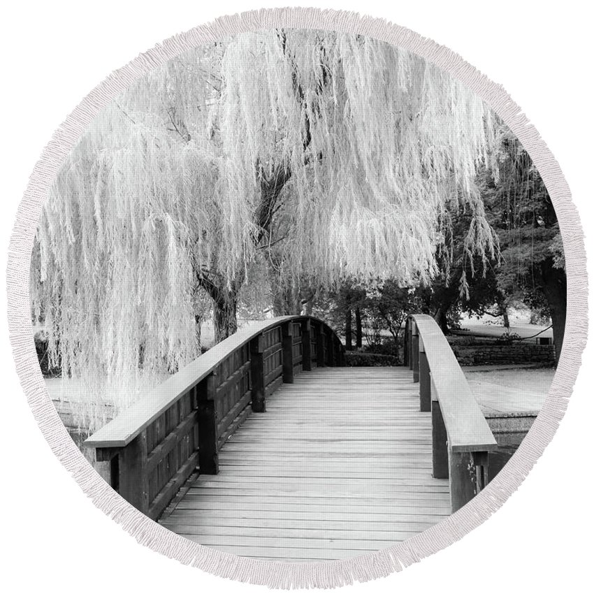 Black And White Photographs Round Beach Towel featuring the photograph Willow Tree Over The Bridge by Terri Morris