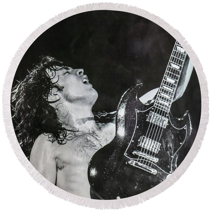 Angus Young Round Beach Towel featuring the photograph Angus Young 1981 ACDC by Leigh Henningham