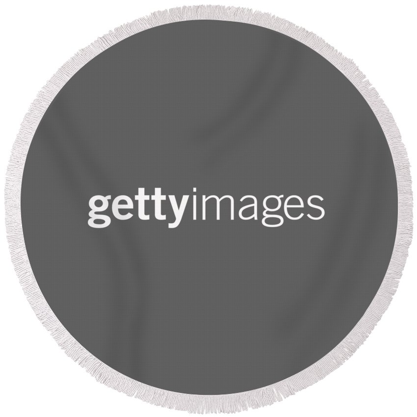 Getty Images Logo Round Beach Towel featuring the digital art Getty Images White Logo by Getty Images