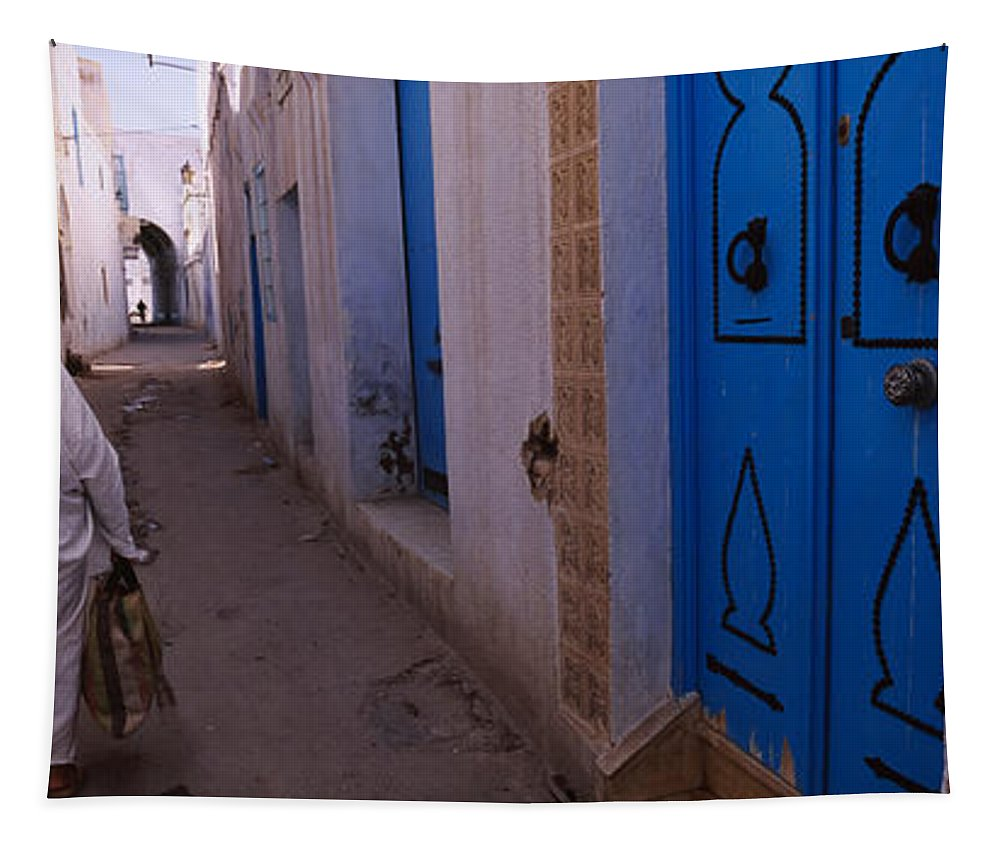 Photography Tapestry featuring the photograph Rear View Of A Woman Walking by Panoramic Images