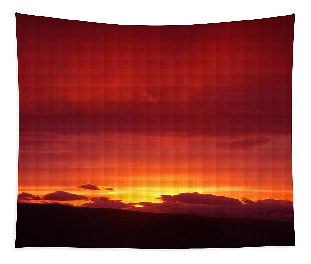 Sunset Tapestry featuring the photograph A Light In The Clouds by Jeff Swan