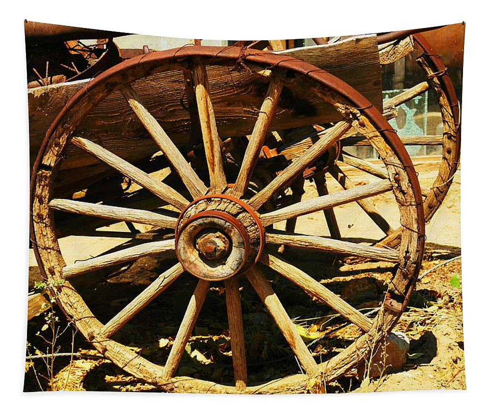 Rounds Tapestry featuring the photograph A Wagon Wheel by Jeff Swan