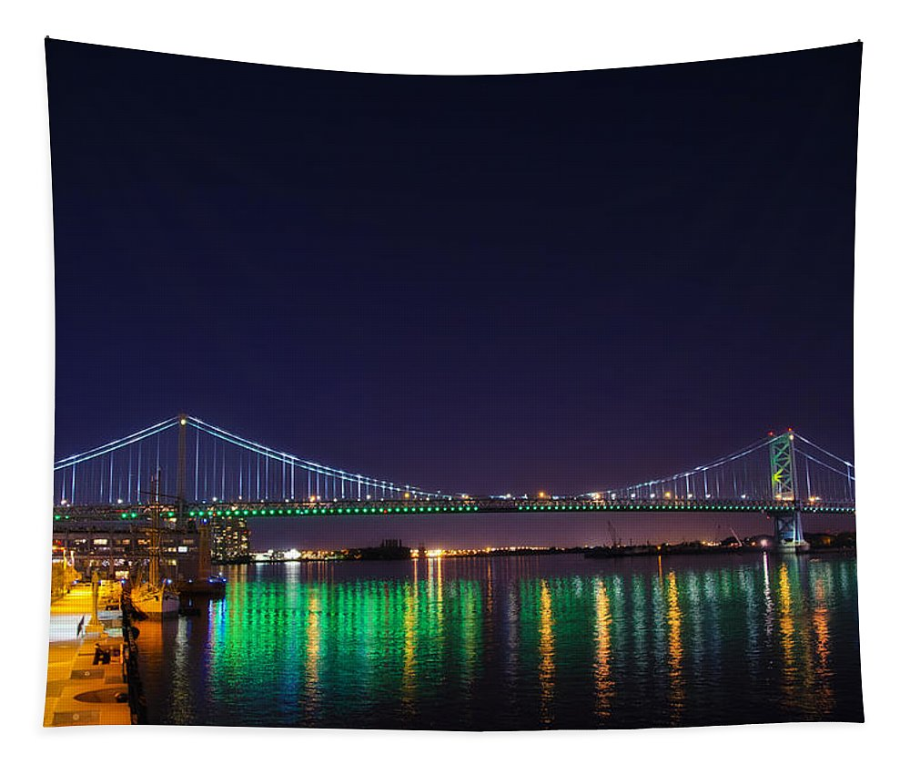 Benjamin Tapestry featuring the photograph Benjamin Franklin Bridge At Night From Penn's Landing by Bill Cannon