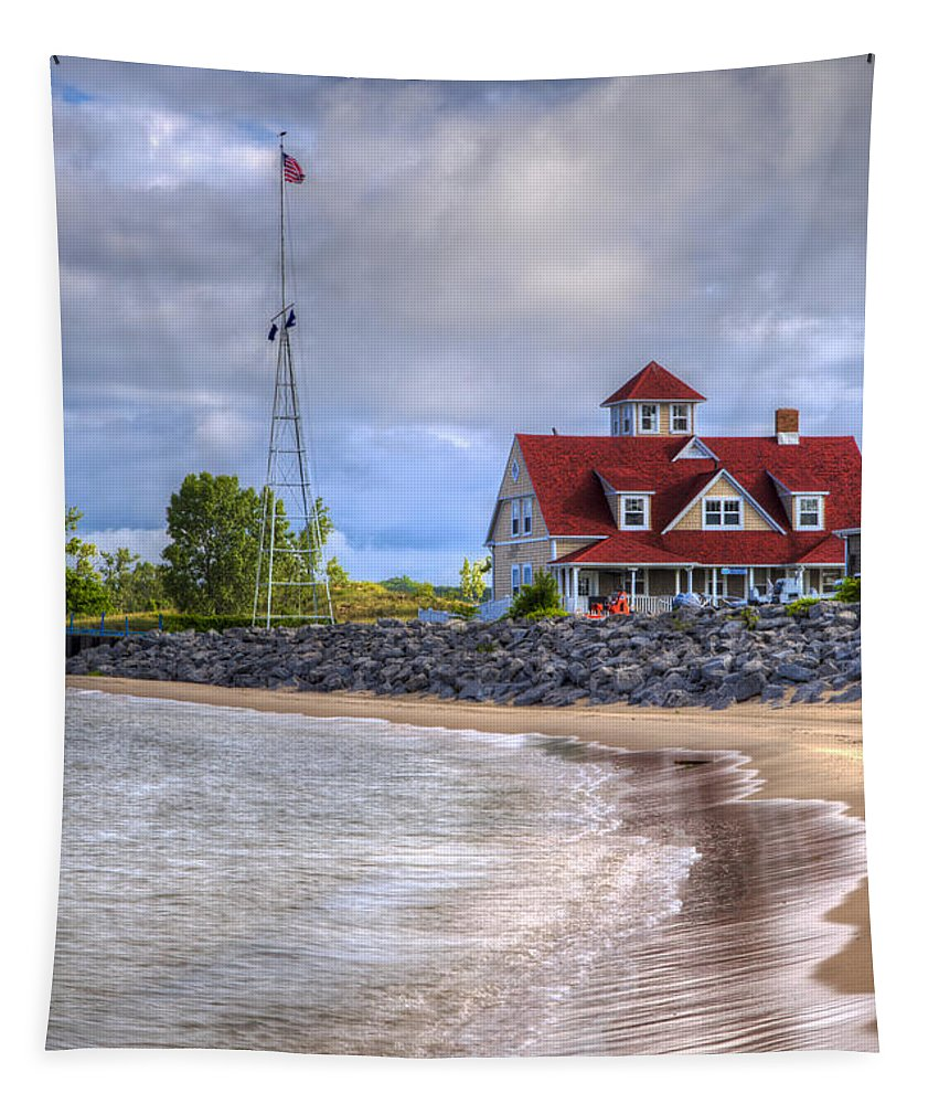 American Tapestry featuring the photograph Coast Guard Station In Muskegon by Debra and Dave Vanderlaan