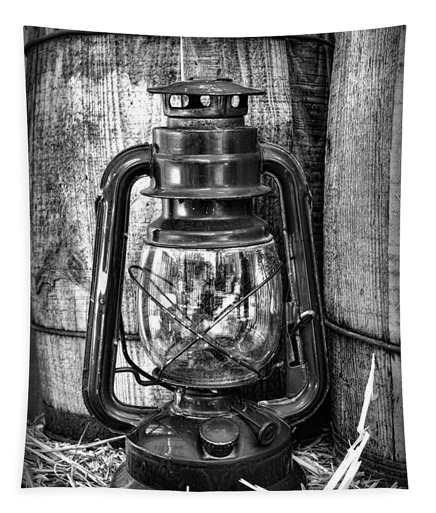Barn Tapestry featuring the photograph Cowboy Themed Wood Barrels And Lantern In Black And White by Paul Ward