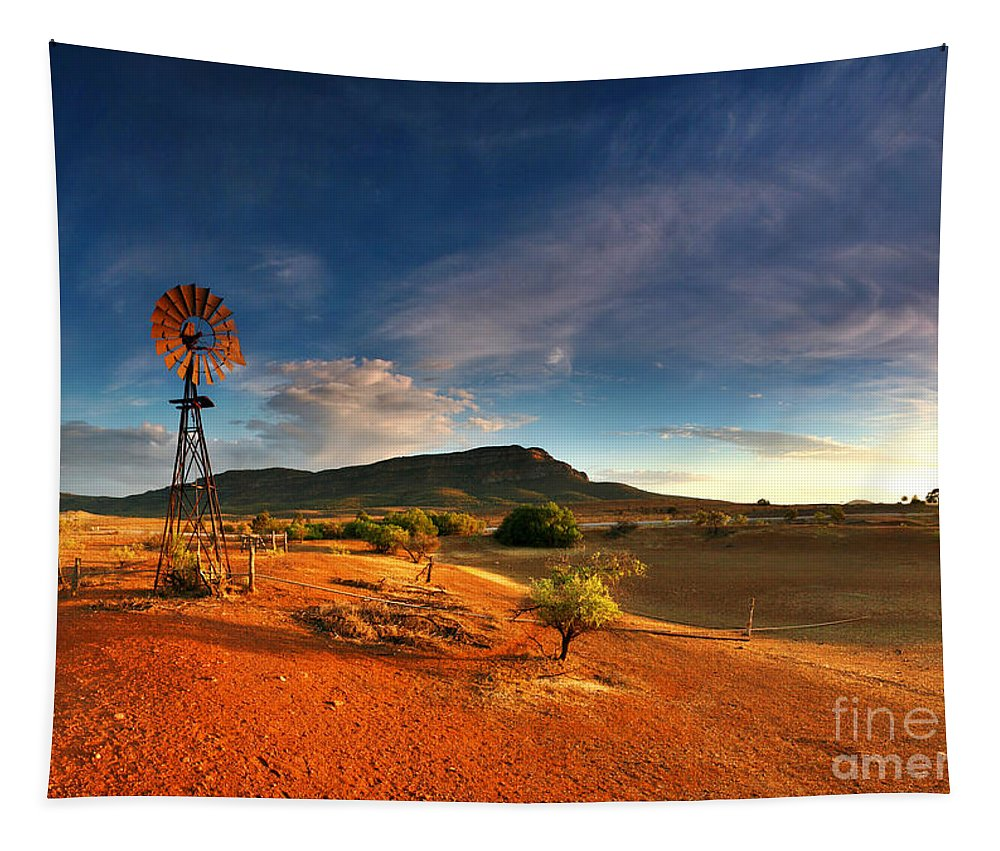 First Light Early Morning Windmill Dam Rawnsley Bluff Wilpena Pound Flinders Ranges South Australia Australian Landscape Landscapes Outback Red Earth Blue Sky Dry Arid Harsh Tapestry featuring the photograph First Light On Wilpena Pound by Bill Robinson
