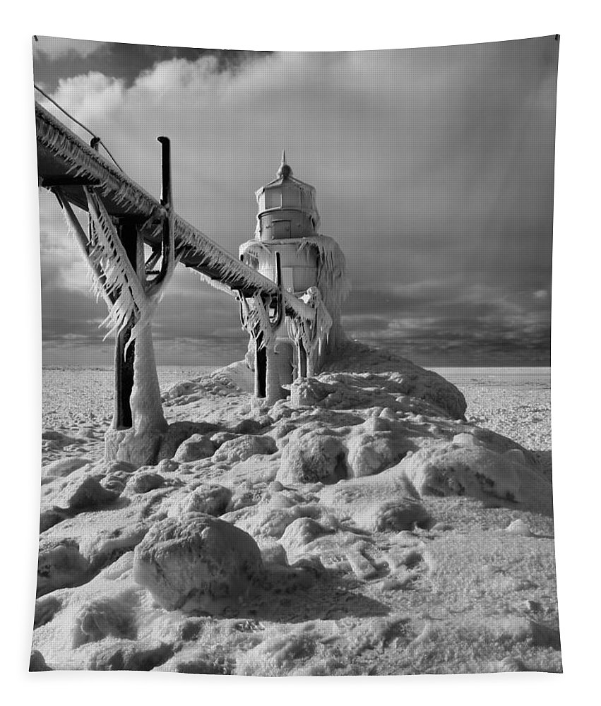 Frozen Grand Haven Lighthouse Black And White Tapestry featuring the photograph Frozen Grand Haven Lighthouse Black And White by Dan Sproul