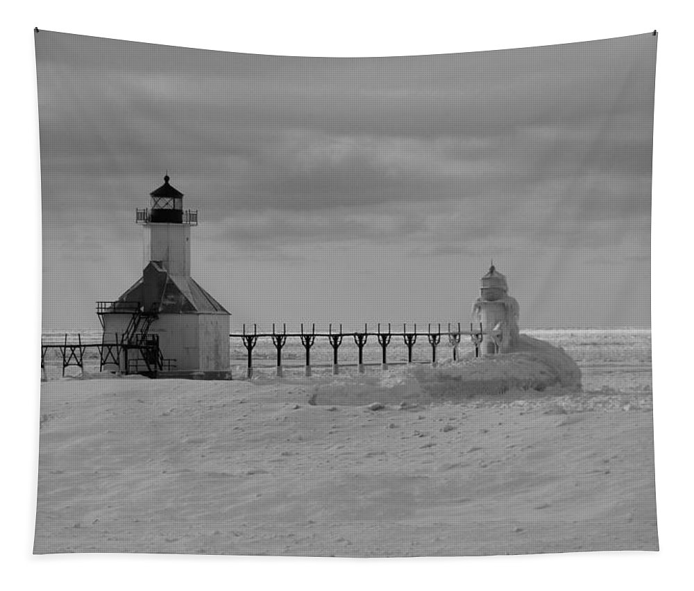 Frozen Grand Haven Lighthouse Black And White Tapestry featuring the photograph Frozen Lighthouses In Michigan by Dan Sproul