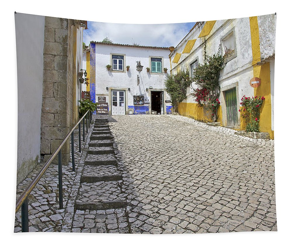 Cobble Tapestry featuring the photograph Medieval Cobblestone Street In The Fortified Walled European Village Of Obidos by David Letts