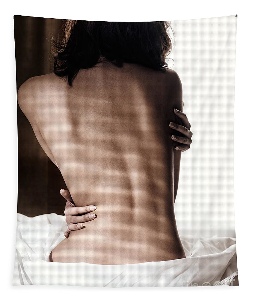 Naked Tapestry featuring the photograph Naked Back Of A Woman Sitting On A Bed In Dramatic Light by Oleksiy Maksymenko
