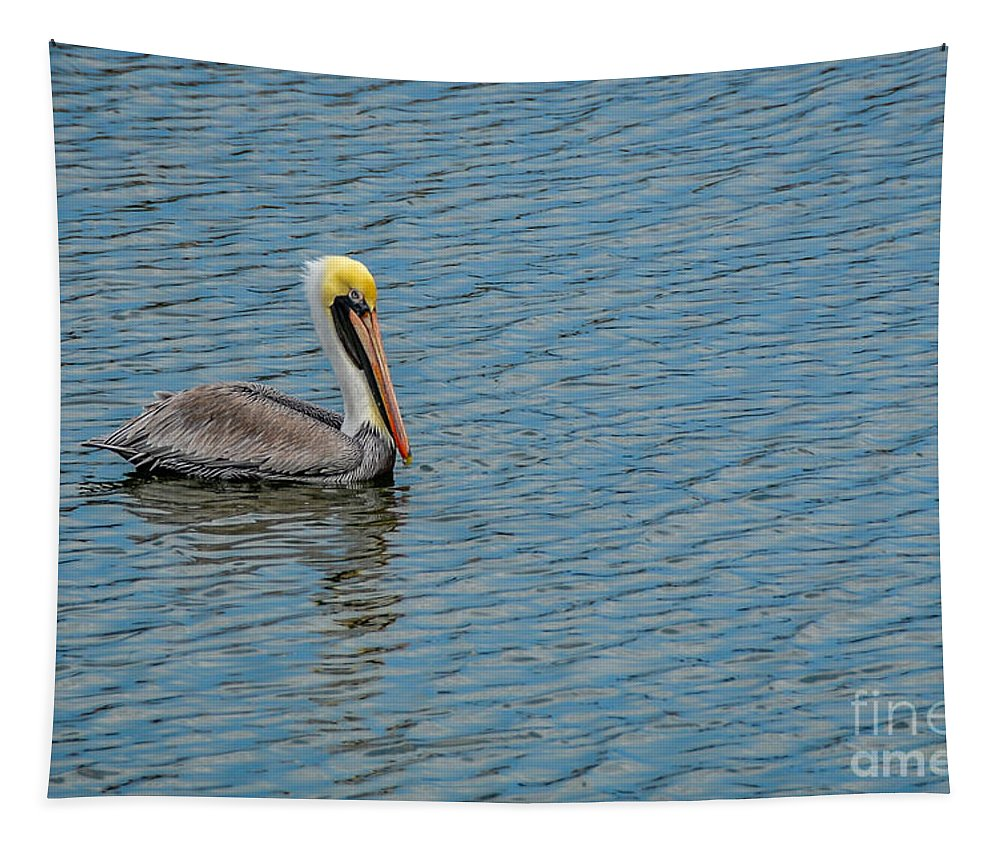 Pelican Drifting On Rippled Water Tapestry featuring the photograph Pelican Drifting On Rippled Water by Debra Martz