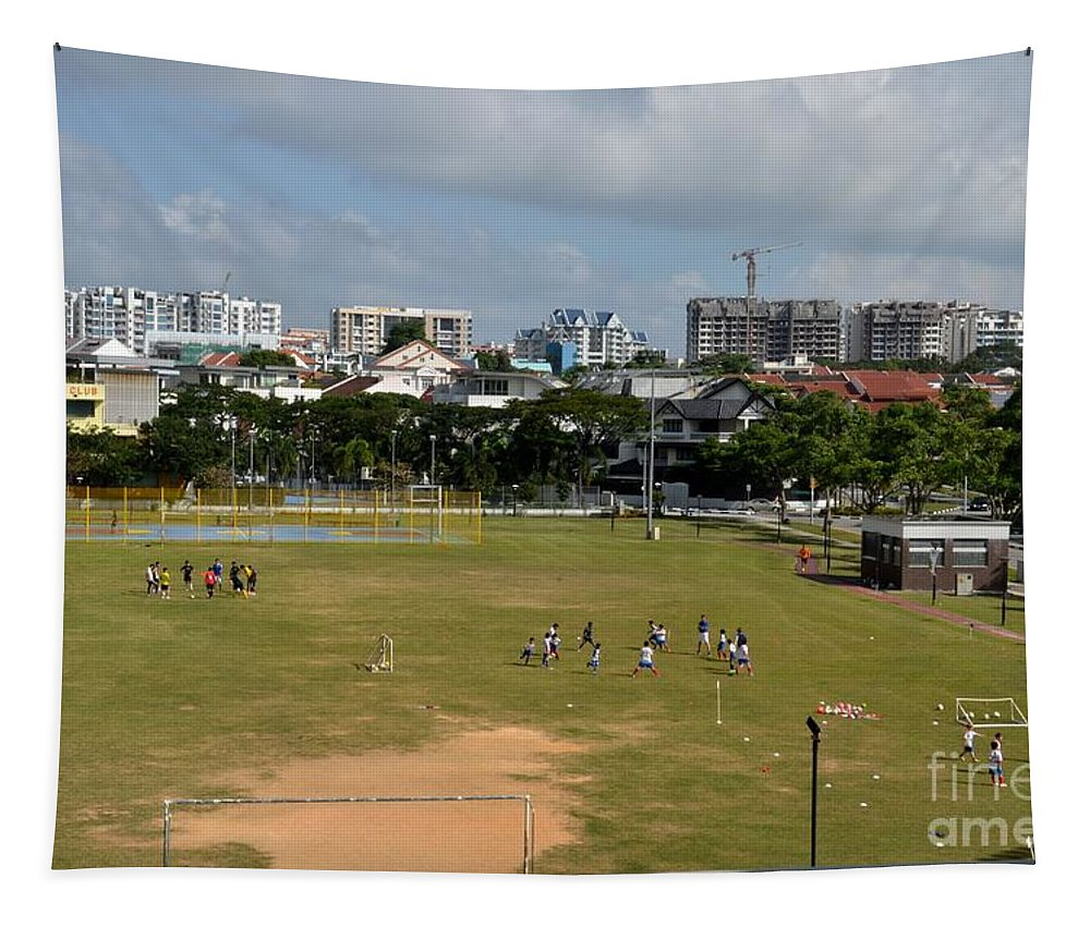 Singapore Children Sports Students Field Games Boy Practice Tapestry featuring the photograph Schoolchildren Practicing On Playing Field With Singapore Skyline In Background by Imran Ahmed