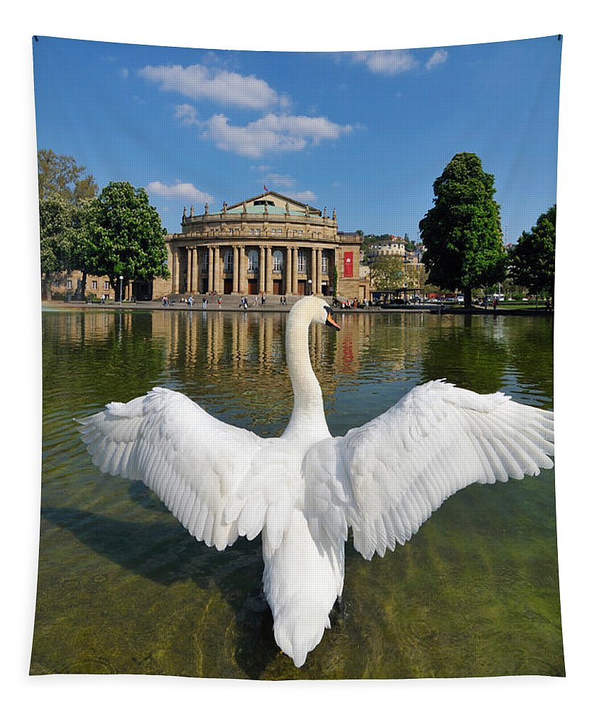Swan Tapestry featuring the photograph Swan Spreads Wings In Front Of State Theatre Stuttgart Germany by Matthias Hauser