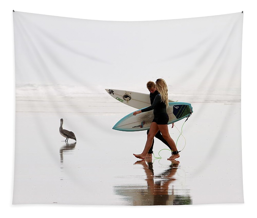 Surfers Tapestry featuring the photograph Surfers And A Pelican by Alice Gipson