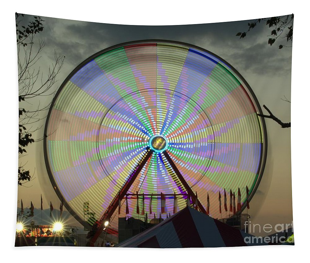 Ferris Wheel Tapestry featuring the photograph The Pinwheel Glow by Donna Brown