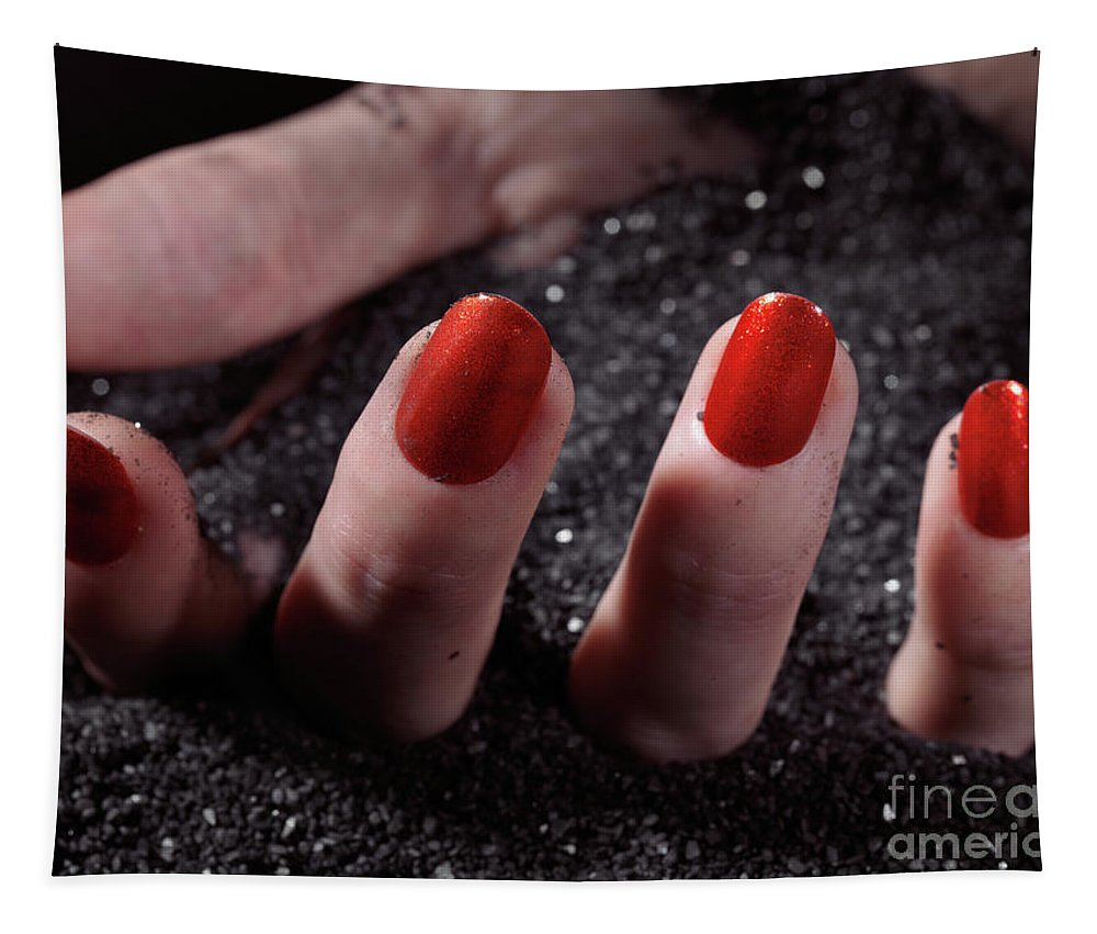 Manicure Tapestry featuring the photograph Woman Hand With Red Nail Polish Buried In Black Sand by Oleksiy Maksymenko