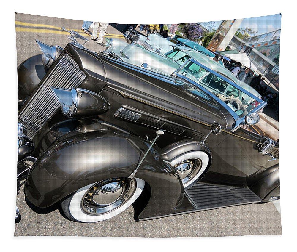 Packard Super 8 Tapestry featuring the photograph A Packard Super 8 by Robert VanDerWal