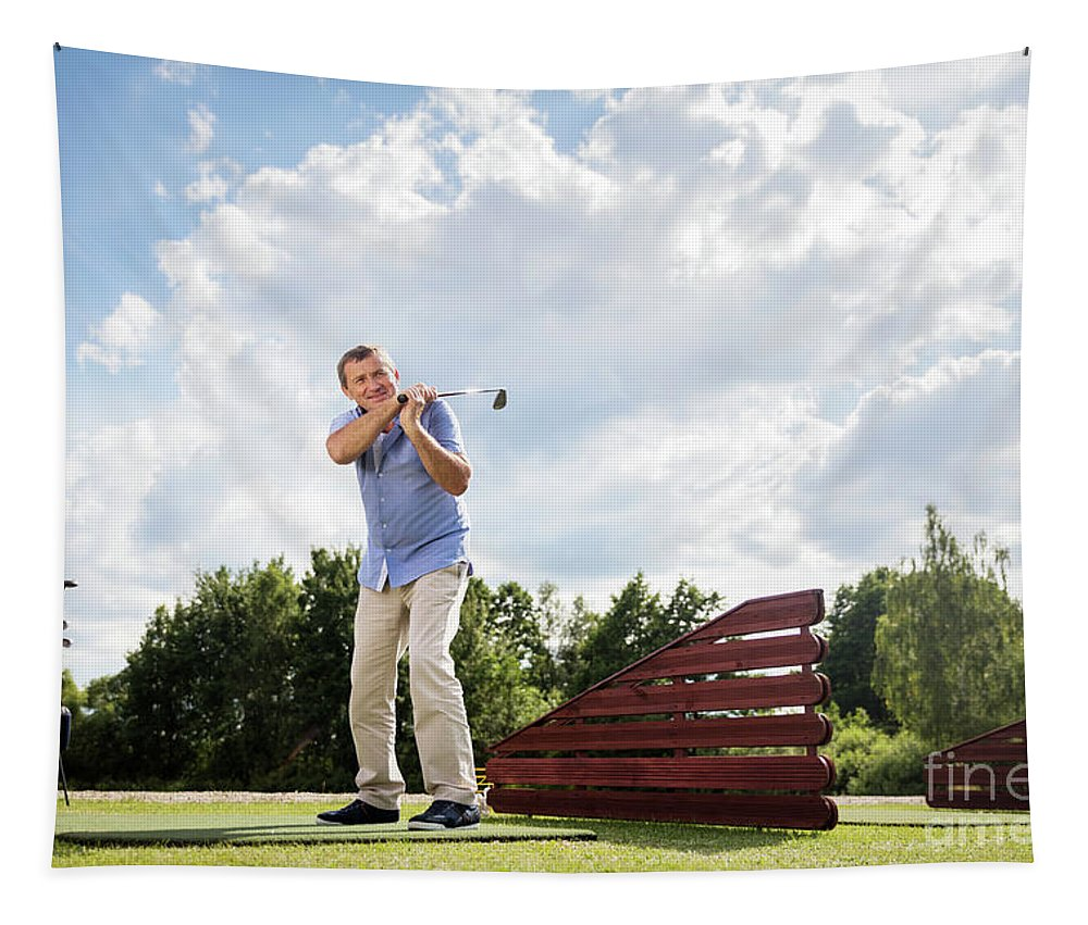 Man Tapestry featuring the photograph Active Senior Man Hitting A Golf Ball. by Michal Bednarek