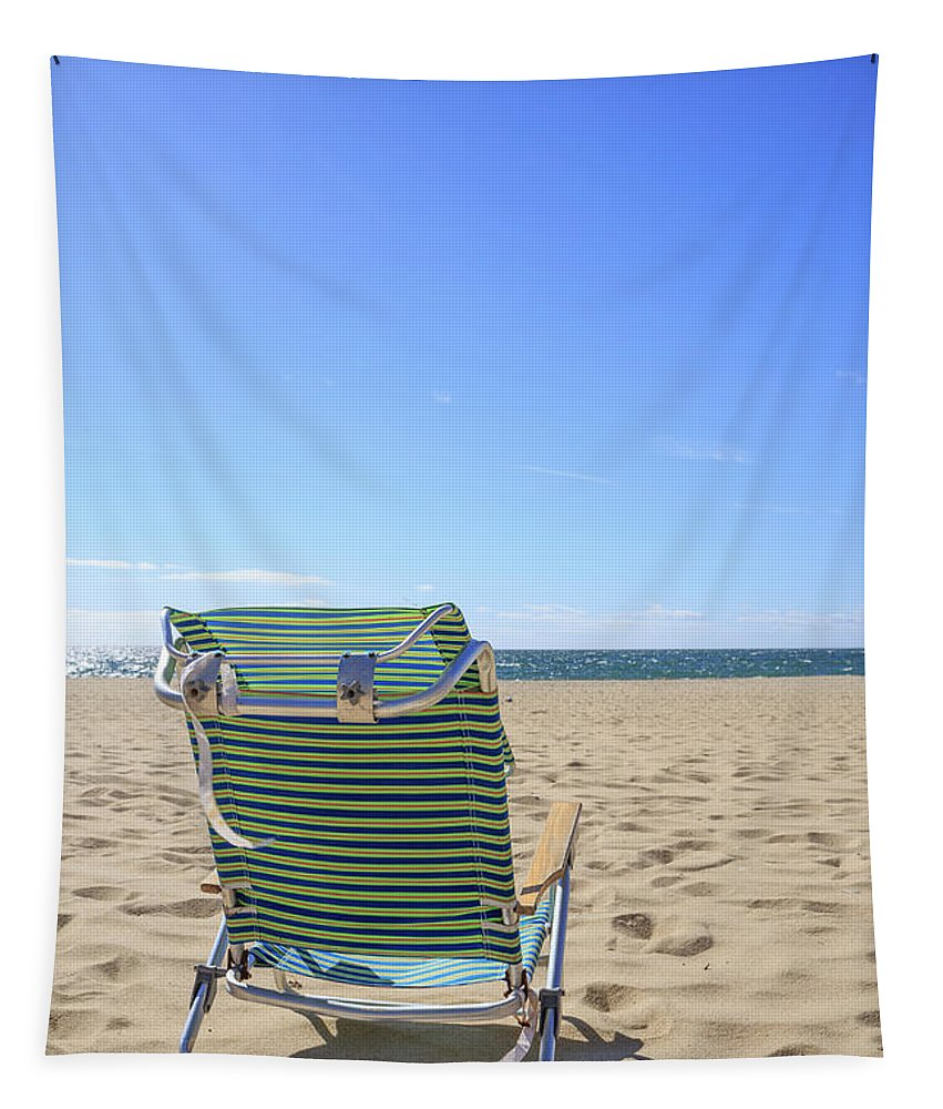 Sand Tapestry featuring the photograph Beach Chair On A Sandy Beach by Edward Fielding
