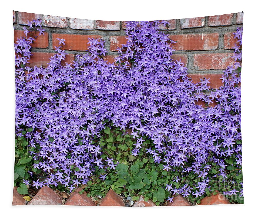 Blue Flowers Tapestry featuring the photograph Brick Wall With Blue Flowers by Carol Groenen