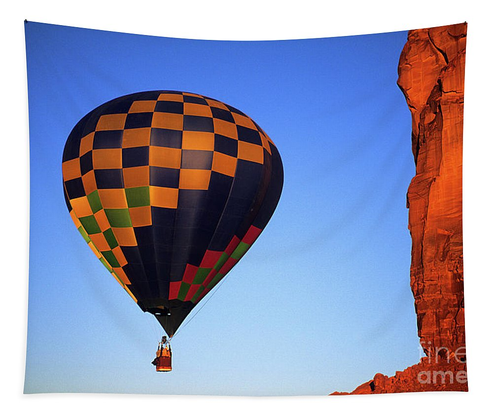 Hot Tapestry featuring the photograph Early Riser Monument Valley by Bob Christopher