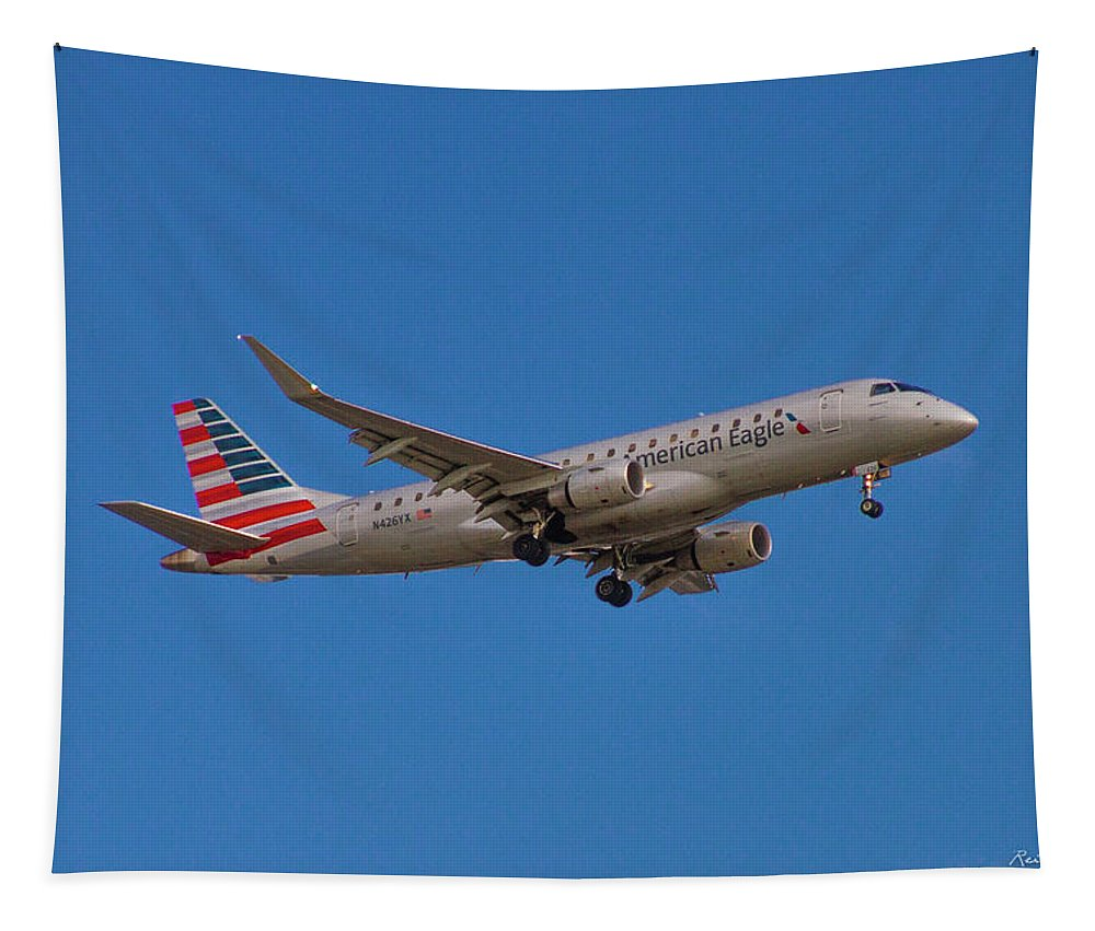 Reid Callaway Flying In Tapestry featuring the photograph Flying In American Eagle Embraer 175 N426yx by Reid Callaway