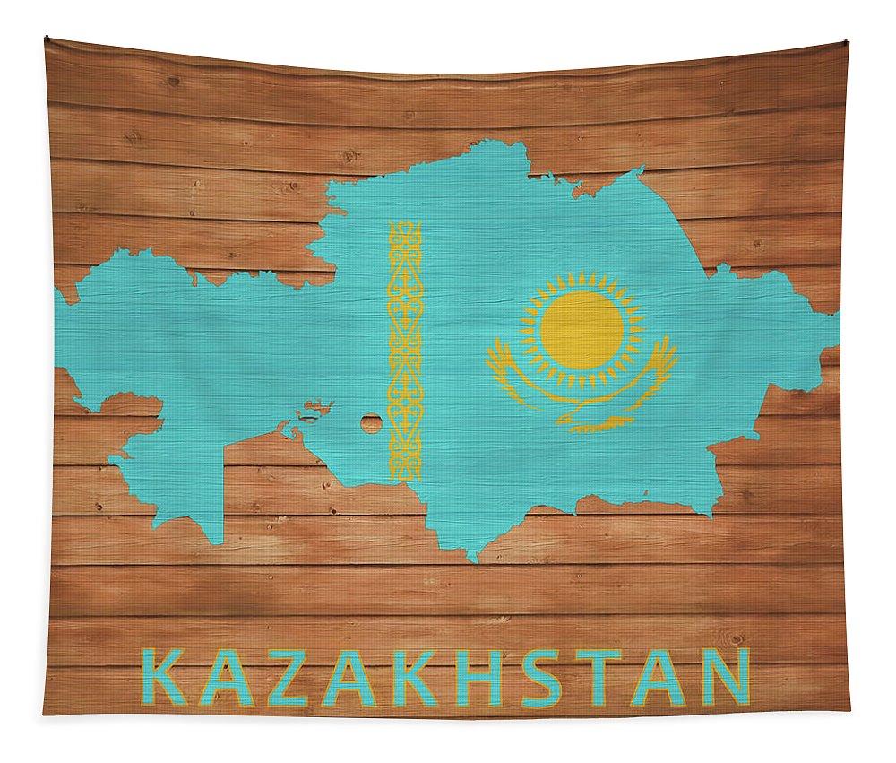 Kazakhstan Rustic Map On Wood Tapestry featuring the mixed media Kazakhstan Rustic Map On Wood by Dan Sproul