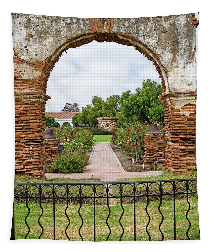Mission San Luis Rey Carriage Arch Tapestry featuring the photograph Mission San Luis Rey Carriage Arch by Robert VanDerWal
