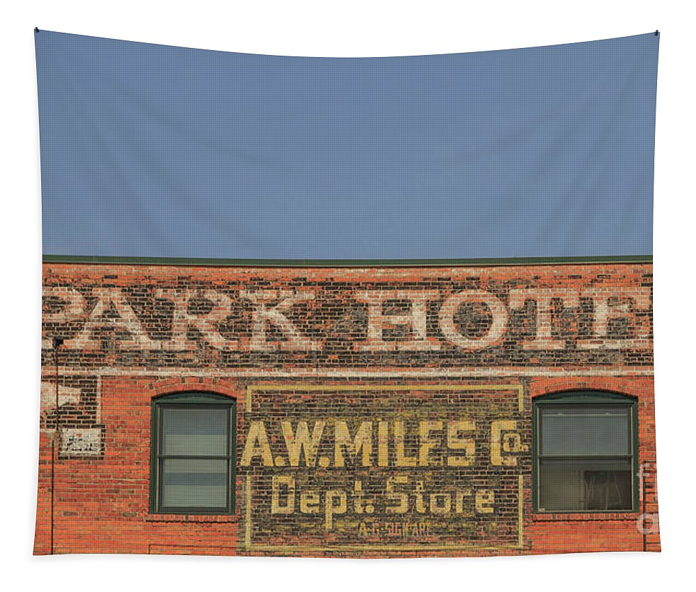 Livingston Tapestry featuring the photograph Old Faded Advertisement On An Old Brick Building by Edward Fielding