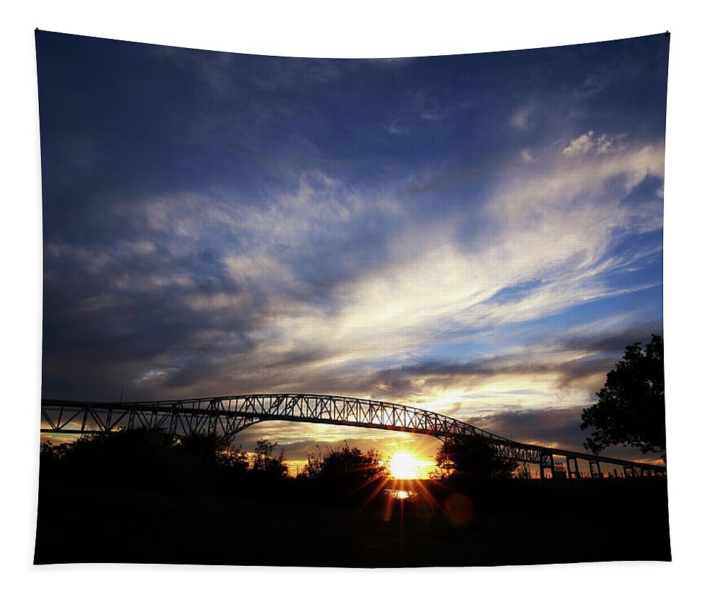 Sunrise Tapestry featuring the photograph Setting Sun And Cloudy Skies by Judy Vincent