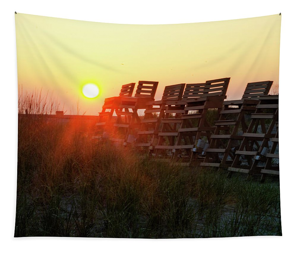Sunrise Tapestry featuring the photograph Sunrise And The Lifeguard Chairs by Bill Cannon