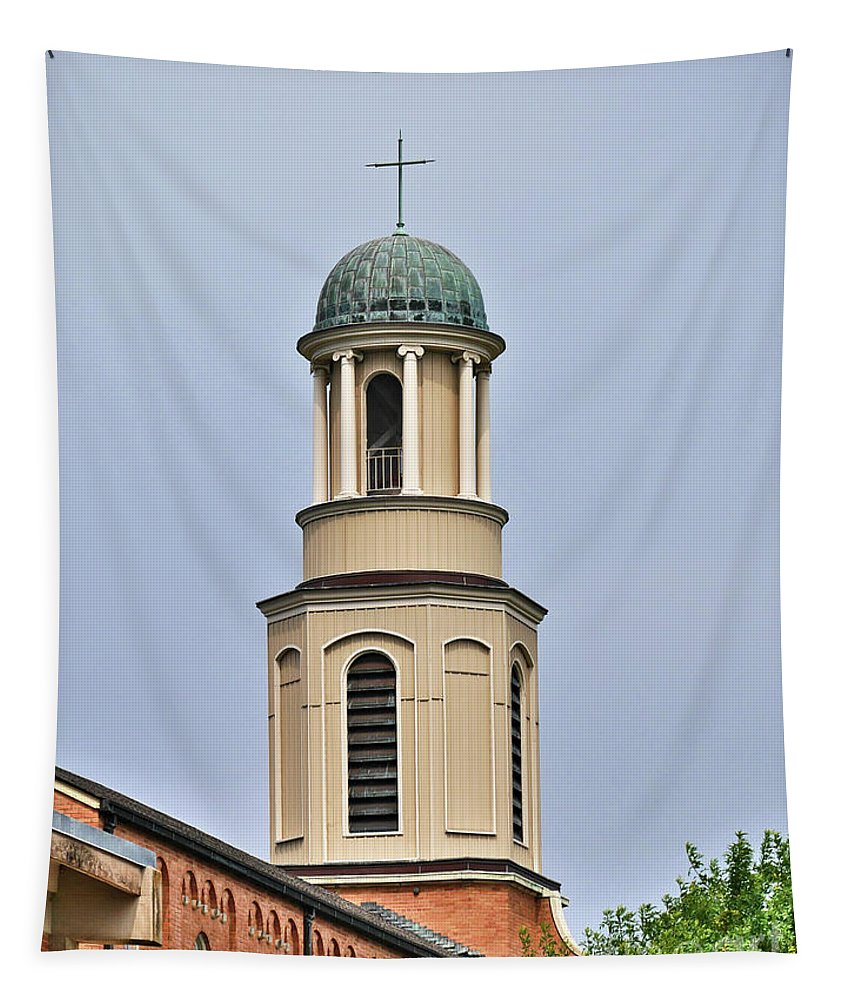 A Cross Sits On Top Of A Church Steeple In Austin Tapestry featuring the photograph The Cross On Top by Gary Richards