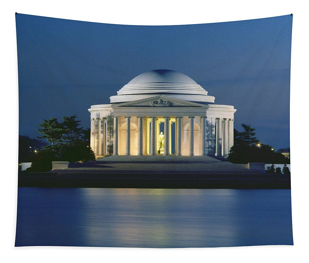 Monument; Saucer Dome; Portico; Columns; Architecture; Architectural; West Potomac Park; Evening; Dusk; Nighttime; Statue; River; Riverbank; Reflection; Nocturne; 3rd; American; Architecture; Neo-classical Tapestry featuring the photograph The Jefferson Memorial by Peter Newark American Pictures