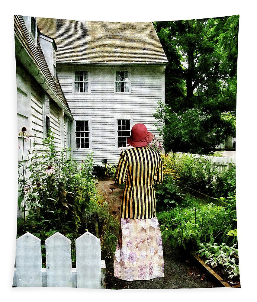 Striped Tapestry featuring the photograph Woman With Striped Jacket And Flowered Skirt by Susan Savad