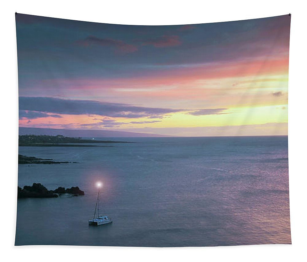 Nature Tapestry featuring the photograph A Catamaran In Honolua Bay At Sunset, Maui, Hawaii by Derrick Neill