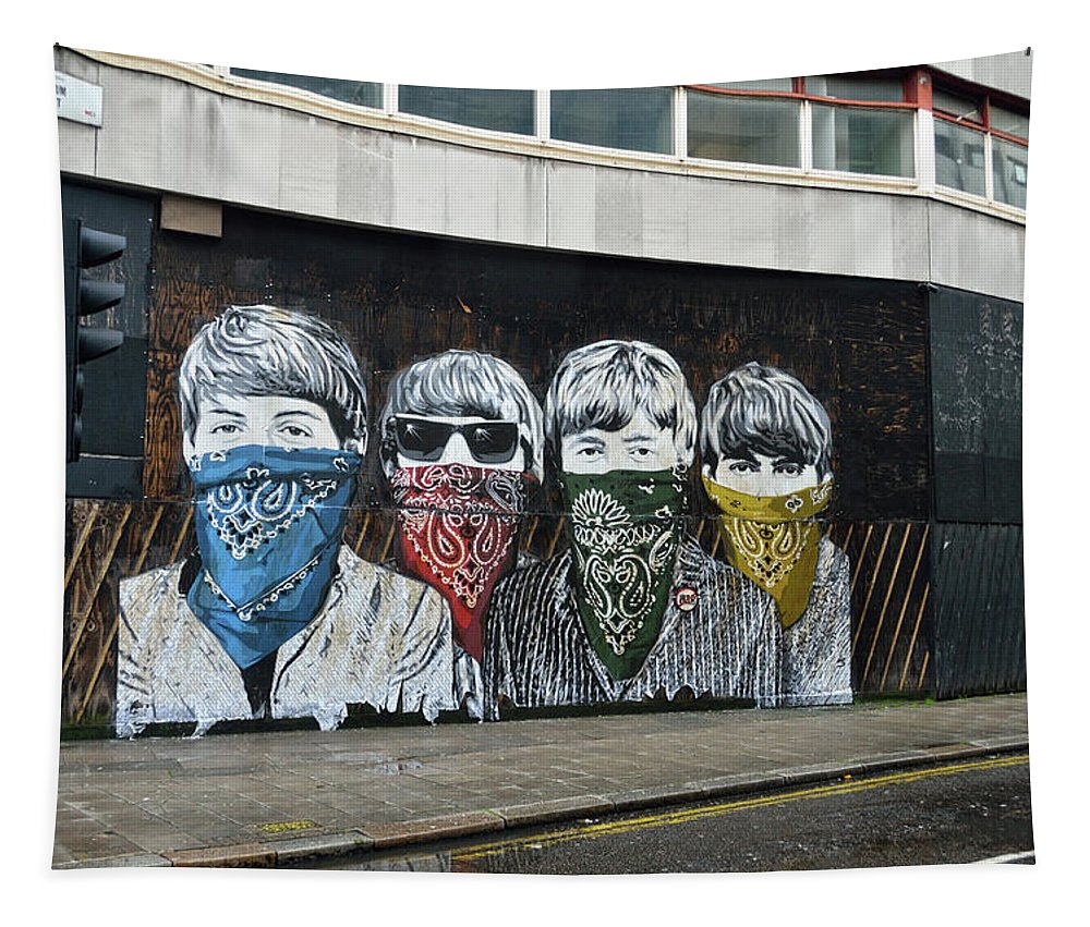 Bansky Tapestry featuring the photograph Yhe Beatles wearing face masks street mural in London by RicardMN Photography