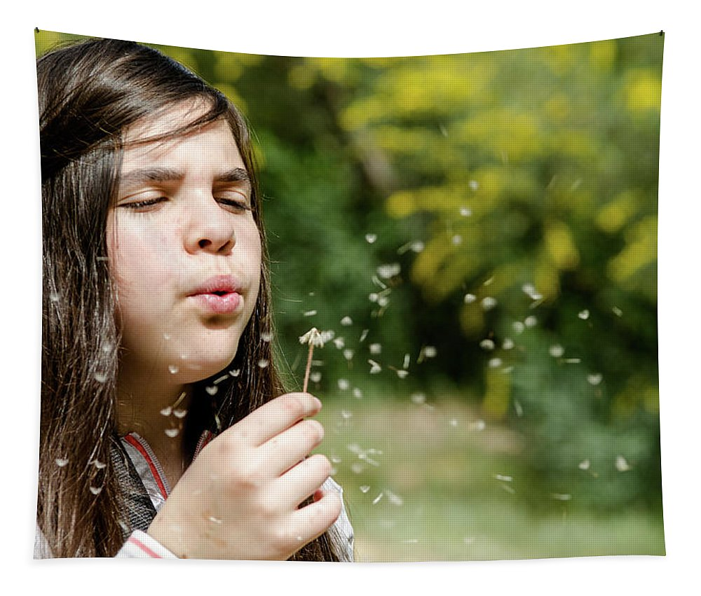 Spring Tapestry featuring the photograph Girl Blowing Dandelion Flower by Michalakis Ppalis