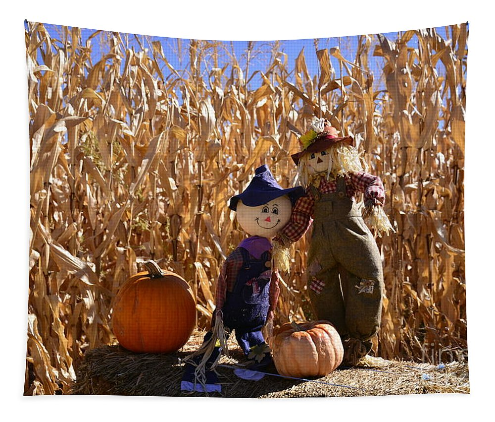 Fall Tapestry featuring the photograph Two Cute Scarecrows With Pumpkins In The Dry Corn Field by Brenda Landdeck