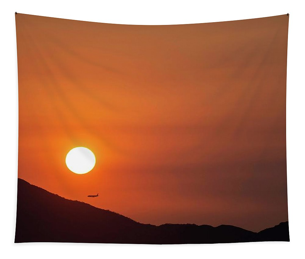 Sunset Tapestry featuring the photograph Red sunset and plane in flight by Hannes Roeckel