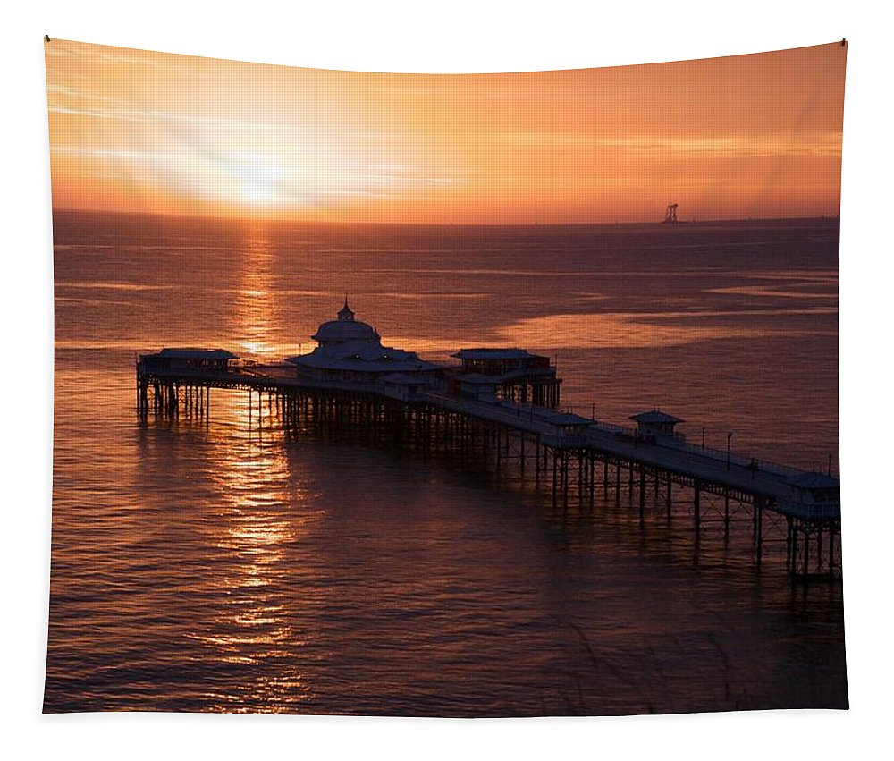 Piers Tapestry featuring the photograph Sunrise over Llandudno pier 2 by Christopher Rowlands