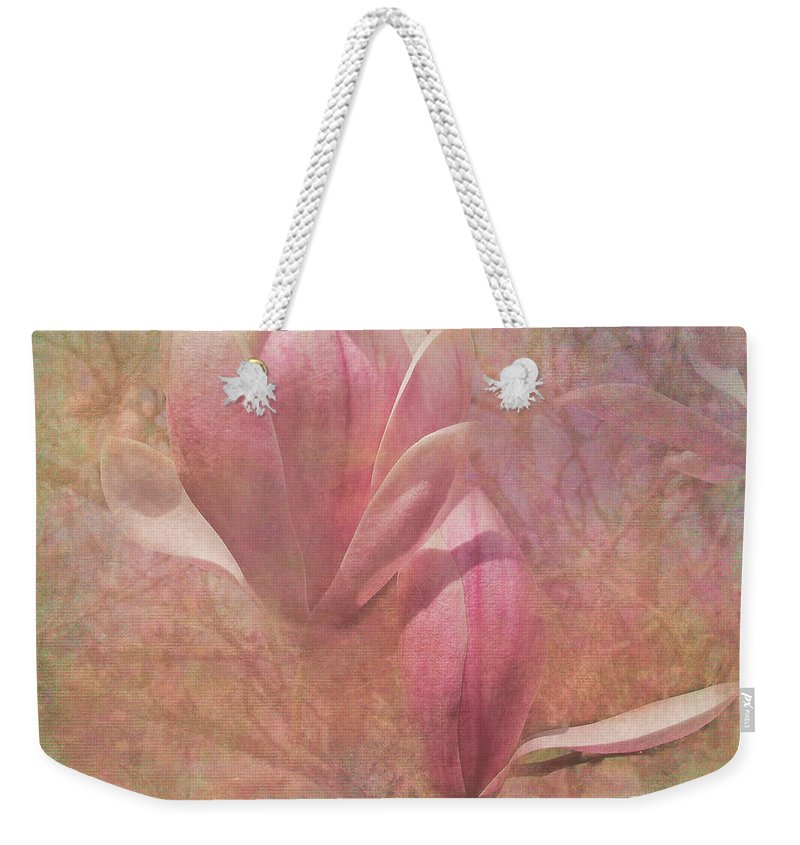 Magnolia Weekender Tote Bag featuring the photograph A Peek Of Spring by Arlene Carmel