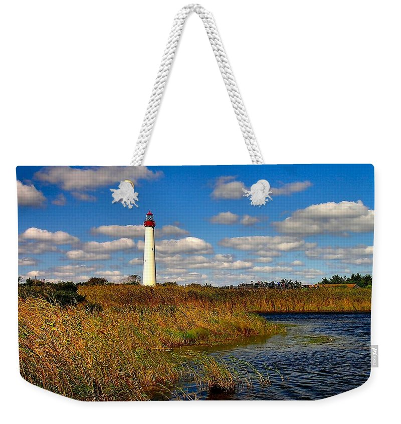 Lighthouse Weekender Tote Bag featuring the photograph Lighthouse At The Water by Nick Zelinsky